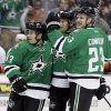 Dallas Stars\' Ray Whitney (13), Sergei Gonchar, center, and Kevin Connauton (23) celebrate a goal by Whitney against the New York Islanders in the first period of an NHL hockey game, Sunday, Jan. 12, 2014, in Dallas. (AP Photo/Tony Gutierrez)
