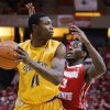 Photo - Wichita State forward Cleanthony Early (11) looks for room to pass under pressure tom Illinois State guard Daishon Knight (3) during the first half of an NCAA college basketball game at Redbird Arena, Wednesday, Jan. 22, 2014, in Normal, Ill. (AP Photo/ Stephen Haas)