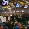 Republican supporters react to the re-election of President Barack Obama as they watch television broadcasts at Peppino\'s in downtown Grand Rapids, Mich., Tuesday, Nov. 6, 2012. (AP Photo/The Grand Rapids Press, Cory Morse) ALL LOCAL TV OUT; LOCAL TV INTERNET OUT
