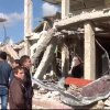 In this photo released by the Syrian official news agency SANA, Syrian citizens gather in front of a damaged building destroyed by a car bomb in Qatana, (25) kilometers (15 miles) southwest of Damascus, Syria, Thursday, Dec. 13, 2012. A bomb blast near a school in a Damascus suburb killed more than a dozen people, at least half of them women and children, the state news agency reported. Russia, Syria\'s most important international ally, said for the first time that President Bashar Assad is increasingly losing control and the opposition may win the civil war. (AP Photo/SANA)