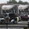 Destroyed vehicles sit in a Kenworth trailer lot after a tornado that swept through the area toppling many of the trailers on the lot Tuesday, April 3, 2012, in Lancaster, Texas. Tornadoes tore through the Dallas area Tuesday, peeling roofs off homes, tossing big-rig trucks into the air and leaving flattened tractor trailers strewn along highways and parking lots. (AP Photo/Tony Gutierrez) ORG XMIT: TXTG102