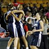From left, Shawnee\'s Kelsey Simmons (13), Monique Tramble (33) and Niki Yu (15) celebrate after winning a Class 5A girls high school basketball game in the semifinals of the state tournament at the Mabee Center in Tulsa, Okla., Friday, March 8, 2013. Shawnee defeated Carl Albert, 50-46, in overtime. Photo by Nate Billings, The Oklahoman