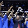 Kansas coach Bill Self holds up the trophy after defeating Texas 85-73 to win an NCAA college basketball game for the championship of the Big 12 men\'s basketball tournament Saturday, March 12, 2011, in Kansas City, Mo. (AP Photo/Charlie Riedel) ORG XMIT: MOOW110