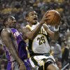 SEATTLE SONICS: Seattle SuperSonics\' Earl Watson (25) drives in front of Phoenix Suns\' Amare Stoudemire in the first quarter of the Sonics home opener in an NBA basketball game Thursday, Nov. 1, 2007, in Seattle. (AP Photo/Elaine Thompson) ORG XMIT: WAET113
