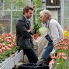 Photo - Bradley Cooper, left, and Jeremy Irons in a scene from