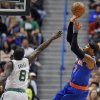 New York Knicks\' Carmelo Anthony, right, shoots a basket while guarded by Boston Celtics\' Jeff Green, left, in the first half of an NBA preseason basketball game Saturday, Oct. 13, 2012, in Hartford, Conn. (AP Photo/Jessica Hill)