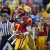 Photo -   UCLA linebacker Anthony Barr, right, forces an incomplete pass as he grabs Southern California quarterback Matt Barkley during the second half of their NCAA college football game, Saturday, Nov. 17, 2012, in Pasadena, Calif. UCLA won 38-28. (AP Photo/Mark J. Terrill)
