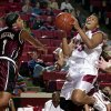 WOMEN\'S COLLEGE BASKETBALL: Oklahoma (OU) Sooner #33 Rosalind Ross goes up for a shot against Texas #1 Toccara Williams of Texas A&M in Wed. nights game at the Lloyd Noble Center in Norman. Staff Photo by Ty Russell.