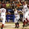 Alabama\'s Jaclyn Traina, right, and Ryan Iamurri celebrate afte Alabama hit a three-run home run in the fourth inning of a Women\'s College World Series game between at ASA Hall of Fame Stadium in Oklahoma City Thursday, May 29, 2014. Photo by Bryan Terry, The Oklahoman