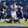 OU\'s Trey Millard (33) out runs the Kansas defense in the third quarter during of the college football game between the University of Oklahoma Sooners (OU) and the University of Kansas Jayhawks (KU) at Memorial Stadium in Lawrence, Kan., Saturday, Oct. 19, 2013. OU won 34-19. Photo by Sarah Phipps, The Oklahoman