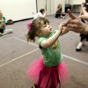 Ryan Intrieri gets help from her mother during Tippi Toes Dance Company\'s Mommy and Me class for kids ages eighteen months to 3 years at the Moore Community Center in Moore, Okla., on Tuesday, Feb. 17, 2009. By John Clanton, The Oklahoman