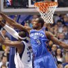 Oklahoma City\'s Serge Ibaka (9) tries to block Dallas\' Brendan Haywood (33) during the pre season NBA game between the Dallas Mavericks and the Oklahoma City Thunder at the American Airlines Center in Dallas, Sunday, Dec. 18, 2011. Photo by Sarah Phipps, The Oklahoman