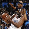 Oklahoma City\'s Malik Rose (9) moves around James Singleton (33) of Dallas in the first half during the NBA basketball game between the Dallas Mavericks and the Oklahoma City Thunder at the Ford Center in Oklahoma City, March 2, 2009. BY NATE BILLINGS, THE OKLAHOMAN