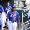 Photo - New York Mets Dilson Herrara walks through the dugout before the baseball game against the Philadelphia Philies at Citi Field on Friday, Aug. 29, 2014, in New York. Herrara is making his major league debut at second base tonight replacing the injured Daniel Murphy. (AP Photo/Kathy Kmonicek)