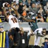 Cincinnati Bengals\' A.J. Green, left, hangs onto a pass as Philadelphia Eagles\' Dominique Rodgers-Cromartie defends in the second half of an NFL football game on Thursday, Dec. 13, 2012, in Philadelphia. (AP Photo/Michael Perez)