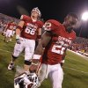 Oklahoma\'s Roy Finch (22) and Bronson Irwin (68) walk off the field after the 41-38 loss to Texas Tech during the college football game between the University of Oklahoma Sooners (OU) and Texas Tech University Red Raiders (TTU) at the Gaylord Family-Oklahoma Memorial Stadium on Sunday, Oct. 23, 2011. in Norman, Okla. Photo by Chris Landsberger, The Oklahoman