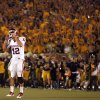 Oklahoma\'s Landry Jones (12) reacts as he walks off the field after a Mossis Madu fumble in the red zone during the first half of the college football game between the University of Oklahoma Sooners (OU) and the University of Missouri Tigers (MU) on Saturday, Oct. 23, 2010, in Columbia, Mo. Photo by Chris Landsberger, The Oklahoman ORG XMIT: KOD