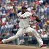Photo - Philadelphia Phillies starting pitcher Roberto Hernandez throws against the Atlanta Braves in the first inning of the first game of a baseball double-header Saturday, June 28, 2014, in Philadelphia.  (AP Photo/H. Rumph Jr)