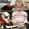 Photo - READING: Paige Fowler, 6, reads to D'Leo, a Dalmatian therapy dog, at the library in Nicoma Park, Oklahoma January 14, 2010. Photo by Steve Gooch, The Oklahoman ORG XMIT: KOD