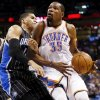 Orlando\'s Tobias Harris (12), left, fouls Oklahoma City\'s Kevin Durant (35) during an NBA basketball game between the Oklahoma City Thunder and the Orlando Magic at Chesapeake Energy Arena in Oklahoma City, Friday, March 15, 2013. Photo by Nate Billings, The Oklahoman