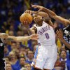 Oklahoma City\'s Russell Westbrook (0) grabs a rebound between San Antonio\'s Danny Green (4) and Tim Duncan (21) during Game 3 of the Western Conference Finals between the Oklahoma City Thunder and the San Antonio Spurs in the NBA playoffs at the Chesapeake Energy Arena in Oklahoma City, Thursday, May 31, 2012. Oklahoma City won, 102-82. Photo by Nate Billings, The Oklahoman