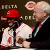 Cincinnati Reds Brandon Phillips laughs with President of Baseball Operations and General Manager Walt Jocketty after anouncing his signing of a six year contract at Great American Ballpark in Cincinnati Tuesday April 10, 2012. Phillips signed a six-year, $72.5 million contract through the 2017 season. (AP Photo/Tom Uhlman)