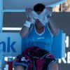 Photo - Lourdes Dominguez Lino of Spain wraps an ice pack around her face during a break in her first round match against Caroline Wozniacki of Denmark at the Australian Open tennis championship in Melbourne, Australia, Tuesday, Jan. 14, 2014.(AP Photo/Rick Rycroft)