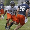 Chicago Bears linebacker Jonathan Bostic (57) works with teammates during NFL football training camp Friday, July 26, 2013, at Olivet Nazarene University in Bourbonnais, Ill. (AP Photo/Nam Y. Huh)