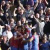 Photo - Crystal Palace's players celebrate Chelsea's own goal, during their English Premier League soccer match at Selhurst Park, London, Saturday, March 29, 2014. (AP Photo/Sang Tan)