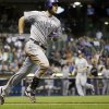 Colorado Rockies\' Ryan Wheeler rounds the bases after hitting a grand slam during the fourth inning of a baseball game against the Milwaukee Brewers Thursday, June 26, 2014, in Milwaukee. (AP Photo/Morry Gash)