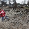 Terra Brown uses a shovel to dig through the ash as she looks for a fire proof safe in her mother\'s home that was destroyed by wildfires on Friday, April 10, 2009, in Choctaw, Okla. Photo by Chris Landsberger, The Oklahoman