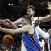 Photo - Memphis Grizzlies' Marc Gasol, back, and O.J. Mayo, right, try to get a rebound against Oklahoma City Thunder center Cole Aldrich (45) in the first half of an NBA basketball game Wednesday, Dec. 28, 2011, in Memphis, Tenn. The Thunder won 98-95. (AP Photo/Lance Murphey) ORG XMIT: TNLM110