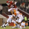 Oklahoma\'s Trey Millard (33) leaps past Florida A&M\'s Jonathan Pillow (19) during the college football game between the University of Oklahoma Sooners (OU) and Florida A&M Rattlers at Gaylord Family—Oklahoma Memorial Stadium in Norman, Okla., Saturday, Sept. 8, 2012. Photo by Bryan Terry, The Oklahoman