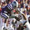 Kansas State Wildcats\' Tramaine Thompson (86) makes a catch in front of Oklahoma Sooners\' Aaron Colvin (14) during the college football game between the University of Oklahoma Sooners (OU) and the Kansas State University Wildcats (KSU) at Bill Snyder Family Stadium on Sunday, Oct. 30, 2011. in Manhattan, Kan. Photo by Chris Landsberger, The Oklahoman ORG XMIT: KOD