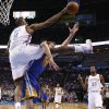 Oklahoma City\'s Serge Ibaka (9) blocks the shot of Golden State\'s David Lee (10) during an NBA basketball game between the Oklahoma City Thunder and the Golden State Warriors at Chesapeake Energy Arena in Oklahoma City, Wednesday, Feb. 6, 2013. Photo by Bryan Terry, The Oklahoman