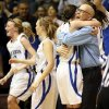 Mount St. Mary head coach Rory Hamilton hugs Kaely Bond (21) as the team celebrate\'s its win over Byng in a Class 4A girls high school basketball game in the first round of the state tournament at the Sawyer Center on the campus of Southern Nazarene University in Bethany, Okla., Thursday, March 7, 2013. Mount St. Mary won, 51-37. Photo by Nate Billings, The Oklahoman