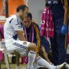Photo -   Los Angeles Galaxy's Landon Donovan, left, sits on the bench after injuring his leg during the second half of an MLS soccer match against Real Salt Lake, Saturday, Oct. 6, 2012, in Carson, Calif. Real Salt Lake won 2-1. (AP Photo/Mark J. Terrill)