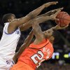 Louisville\'s Chane Behanan looks to shoot over Kentucky\'s Darius Miller, left, during the second half of an NCAA Final Four semifinal college basketball tournament game Saturday, March 31, 2012, in New Orleans. (AP Photo/Mark Humphrey)