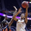 Photo - Tennessee forward Bashaara Graves (12) shoots over Auburn center Tra'Cee Tanner (44) in the first half of an NCAA college basketball game, Thursday, Feb. 20, 2014, in Knoxville, Tenn. (AP Photo/Wade Payne)
