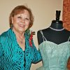 Liz Codding with her 1957 prom dress from her \'Hope Chest\' for a \'senior\' prom held recently at Touchmark at Coffee Creek. Cheyenne Middle School students helped with the prom.