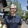 Photo -   In his Thursday, July 12, 2012 photo, Apple CEO Tim Cook walks to the Allen & Company Sun Valley Conference in Sun Valley, Idaho. Apple Inc. reports quarterly financial results after the market closes on Tuesday, July 24. (AP Photo/Paul Sakuma)