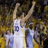 Golden State Warriors\' Stephen Curry (30) reacts as Denver Nuggets\' Ty Lawson watches, right, at the end of Game 3 in a first-round NBA basketball playoff series on Friday, April 26, 2013, in Oakland, Calif. (AP Photo/Ben Margot)