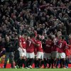 Manchester United players celebrate as they win their 20th English Premier League title after their 3-0 win over Aston Villa in their soccer match at Old Trafford Stadium, Manchester, England, Monday April 22, 2013. (AP Photo/Jon Super)