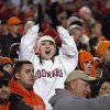 Fan Heather Doss celebrates a Sooner touchdwon during the Bedlam college football game between the University of Oklahoma Sooners (OU) and the Oklahoma State University Cowboys (OSU) at Boone Pickens Stadium in Stillwater, Okla., Saturday, Nov. 27, 2010. Photo by Sarah Phipps, The Oklahoman