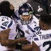 Photo - Seattle Seahawks' Russell Wilson celebrates with Marshawn Lynch and Walter Thurmond during the second half of the NFL Super Bowl XLVIII football game against the Denver Broncos Sunday, Feb. 2, 2014, in East Rutherford, N.J.  The Seahawks won 43-8. (AP Photo/Charlie Riedel)