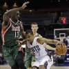 Charlotte Bobcats\' Ramon Sessions (7) drives past Milwaukee Bucks\' Ekpe Udoh (13) during the first half of an NBA basketball game in Charlotte, N.C., Monday, Nov. 19, 2012. (AP Photo/Chuck Burton)