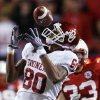 Photo - Oklahoma's Adron Tennell (80) misses a catch during the first half of the college football game between the University of Oklahoma Sooners (OU) and the University of Nebraska Cornhuskers (NU) on Saturday, Nov. 7, 2009, in Lincoln, Neb.  Photo by Chris Landsberger, The Oklahoman ORG XMIT: KOD