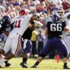 Oklahoma\'s R.J. Washington (11) forces a fumble by Trevone Boykin (2) during the second half of the college football game where the University of Oklahoma Sooners (OU) defeated the Texas Christian University Horned Frogs (TCU) 24-17 at Amon G. Carter Stadium in Fort Worth, Texas, on Saturday, Dec. 1, 2012. Photo by Steve Sisney, The Oklahoman