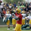 Green Bay Packers\' Aaron Rodgers throws a ball during NFL football training camp Saturday, July 27, 2013, in Green Bay, Wis. (AP Photo/Morry Gash)