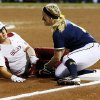 OU\'s Georgia Casey (42) is out as she slides into Michigan\'s Amy Knapp (1) in the first inning during an NCAA softball game in the Women\'s College World Series between Oklahoma and Michigan at ASA Hall of Fame Stadium, Thursday, May 30, 2013. Photo by Nate Billings, The Oklahoman